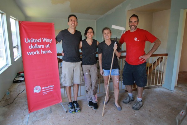 McCarthy Tetrault Hollyburn volunteers helping transform a house for homeless and at risk seniors.