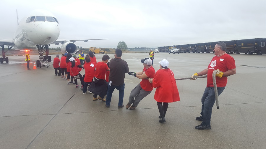 A team competes in timed trials at the 3rd annual UPS Plane Pull for United Way.